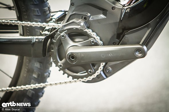 Standard sized chain rings and integrated chain guide up front.